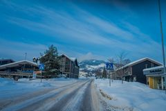 GOL, NORWAR, APRIL, 02, 2018: Gorgeous outdoor view of some buildings located at one side of the road with snow during. Winter season in GOL, Norway stock image