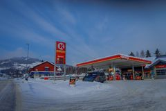 GOL, NORWAR, APRIL, 02, 2018: Outdoor view of some cars in a gas station, covered with snow in GOL. Norway Royalty Free Stock Photography