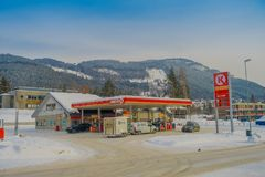 GOL, NORWAR, APRIL, 02, 2018: Outdoor view of some cars in a gas station, covered with snow in GOL. Norway Royalty Free Stock Photo
