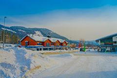 GOL, NORWAR, APRIL, 02, 2018: Winter outdoor view of red wooden buildings located in dowtown covered with snow during a. Winter in the city of GOL, Norway Royalty Free Stock Photography