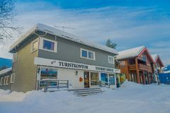 GOL, NORWAR, APRIL, 02, 2018: Winter outdoor view of wooden buildings located in dowtown covered with snow during a. Winter in the city of GOL, Norway Stock Image