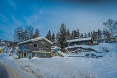 GOL, NORWAR, APRIL, 02, 2018: Winter outdoor view of wooden buildings located in dowtown covered with snow during a. Winter in the city of GOL, Norway Royalty Free Stock Photo