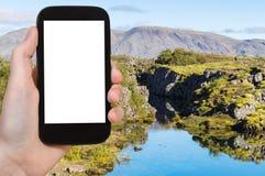 Gola turistica di Silfra del photographsf in Thingvellir Immagini Stock