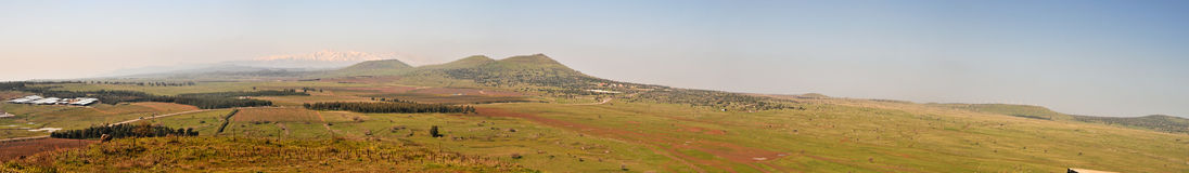 Golan Heights landscape panorama. Border of Israel with Syria is situated to the line of volcanic mounts. From  this strategic point you can look deep into Stock Images