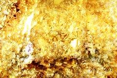 Goldöl-Flüssigkeitshintergrund Lizenzfreies Stockbild