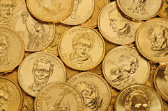 Gold $1 Coins. Layer of gold one dollar U.S. Presidential coins stock photos