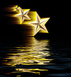 Gold 3D Shooting Stars Reflecting in Water Stock Image