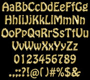 Gold abc. Golden letters on black background royalty free illustration