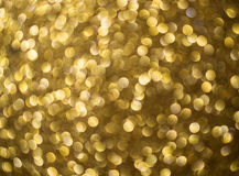 Gold abstract background bokeh circles for Christmas background. Royalty Free Stock Photos