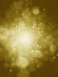 Gold abstract background with bokeh lights and stars Stock Image