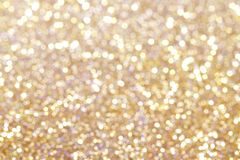 Gold abstract bokeh background royalty free stock photography