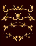 Gold abstract design elements. On a dark red background Stock Images