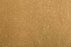 Gold abstract glitter background. Close up stock photo