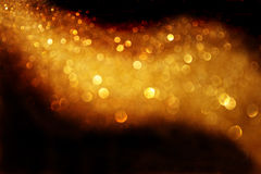 Gold abstract glitter trail background made of defocused lights royalty free stock images