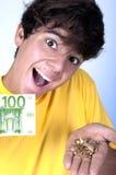 Gold against cash money. Guy selling gold against cash money Stock Photos