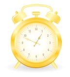 Gold alarm clock Stock Image