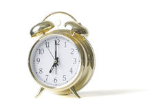 Gold alarm clock Stock Image