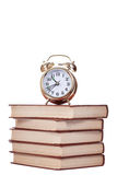 Gold alarm clock stand on a pile of books Stock Photography
