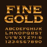 Gold alphabet font. Luxury glossy letters, numbers and symbols. Stock Images