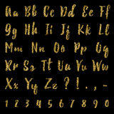 Gold alphabet isolated on black background. Lettering. Gold dotted, confetti alphabet isolated on black background. Letters, numbers and punctuation marks. ABC Royalty Free Stock Photos