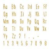 Gold alphabet isolated on white background. Lettering. Gold dotted, confetti alphabet isolated on white background. Letters, numbers and punctuation marks. ABC Stock Photo