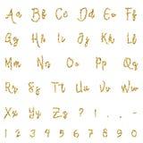 Gold alphabet isolated on white background. Lettering. Gold dotted, confetti alphabet isolated on white background. Letters, numbers and punctuation marks. ABC Royalty Free Stock Images