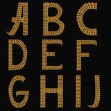 Gold Alphabet Letters Uppercase A - J on black background isolat Stock Photo