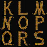 Gold Alphabet Letters Uppercase K - S on black background isolat Royalty Free Stock Photo