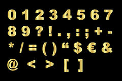 Gold alphabet - numbers and symbols royalty free stock image