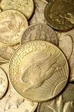 Gold american coins. Gold american and european coins for cash background stock photo