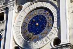 Gold zodiac signs and astronomical clock in a sunny day. Gold, ancient zodiac signs and astronomical clock in a sunny day stock photo
