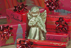 Gold angel with christmas gifts Stock Photography