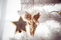 Gold angel christmas toy on the tree. Vintage colors. Stock Image