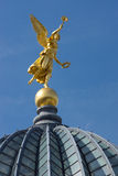 Gold angel in Dresden. The golden angel on the cuppola of the University of arts in Dresden Royalty Free Stock Photo