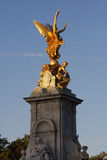 Gold angel on monument Royalty Free Stock Photos
