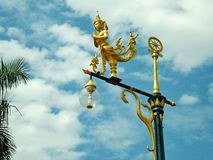 Gold angel on pole. On sky Stock Photography