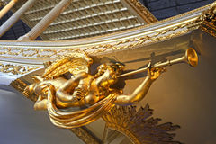 Gold angel statue on baroque ship Stock Photos