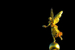 Gold angel statue black background royalty free stock photos