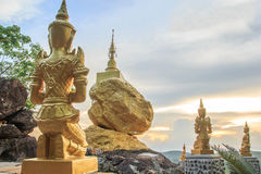 Gold Angel statue and gold pagoda Royalty Free Stock Photo