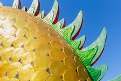 Gold animal scales sculpture. Stock Photos