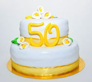 Gold anniversary celebration fondant cake Stock Photography