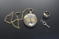 Gold antique pocket watch and fob Royalty Free Stock Image