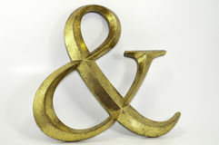 Gold antiqued ampersand symbol Royalty Free Stock Photo