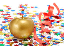 Gold apple. With a red ribbon Royalty Free Stock Photo