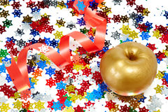 Gold apple. With a red tape Royalty Free Stock Photo
