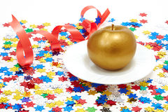 Gold apple. With a red tape Stock Photography