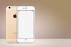 Gold Apple iPhone 7 mockup front and back side on gold background with copy space Royalty Free Stock Image