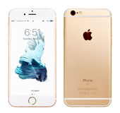 Gold Apple iPhone 6S. Kyiv, Ukraine - April 30, 2017: Front view of Gold Apple iPhone 6S with iOS 10.3.1 mobile operating system and back side with Apple Inc Stock Photo