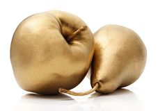 Gold apple and pear Stock Photos
