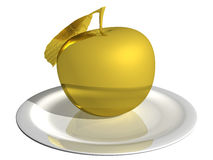 Gold apple on a white plate isolated on white background Royalty Free Stock Image